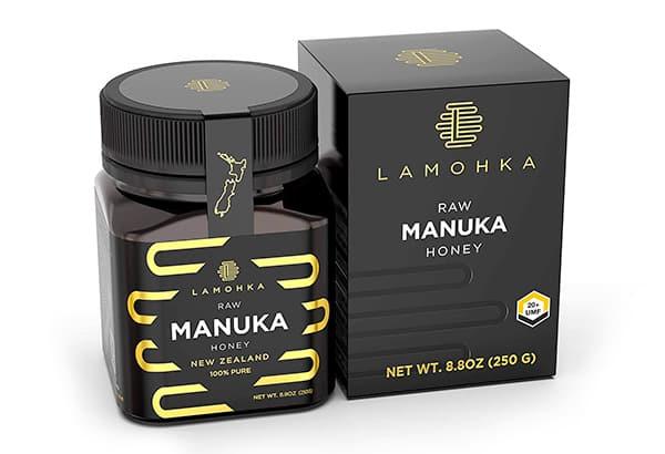 Golden embellishment for black tuck end box